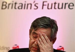 Britain's Prime Minister Gordon Brown rubs his eye as he speaks at a school in south London, Tuesday May 5, 2009 in London.