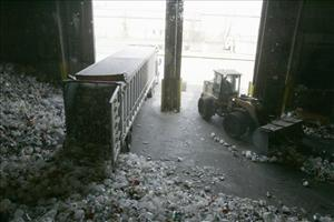 A truck delivers a load of plastic bottles and other containers to the Stratford, Conn., recycling center, part of The Garbage Museum.