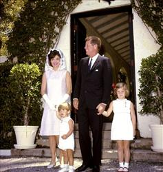 John F. Kennedy and family outside the Palm Beach, Fla. home of the president's father in 1963.