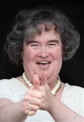Susan Boyle, who's performance on the television show Britain's Got Talent wowed the judges, gives the thumbs up at her home in Blackburn, Scotland, Thursday April 16, 2009.