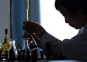 A chemist tests a chemical at a laboratory inside the Testing Center for Vegetable Quality of the Ministry of Agriculture in Beijing, China, Thursday, August 2, 2007. Fears were triggered earlier this year after a Chinese-made ingredient in pet food was linked to the deaths of cat and dogs in...