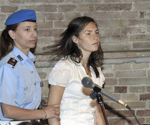 US murder suspect Amanda Knox is escorted by a penitentiary police officer as she arrives for a hearing in the Meredith Kercher murder trial, in Perugia, Italy, Saturday, June 6, 2009.