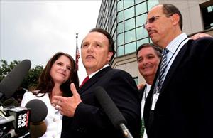In 2005, Richard Scrushy, second from left, with his wife Leslie and attorneys, meets with reporters outside the Hugo Black Federal Courthouse in Birmingham, Ala.