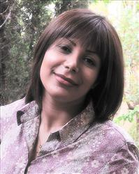 This May 2009 photo provided by Caspian Makan, 37-year-old photojournalist in Tehran who identified himself as Neda Agha Soltan's boyfriend purports to show Neda Agha Soltan.