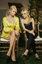 Paris Hilton and Nicole Richie of The Simple Life infamy pose during an interview.