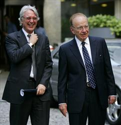 Rupert Murdoch, right, stands with Les Hinton after attending a service at St Bride's Church on Fleet Street, London in 2005.
