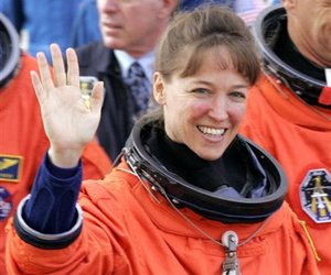 Space Shuttle Discovery Mission Specialist Lisa Nowak waves prior to boarding the astrovan en route to the orbiter at the Kennedy Space Center, Fla., in this July 2, 2006, file photo.