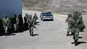 Mexican soldiers patrol the streets of Aguililla, Mexico, in the western state of Michoacan.