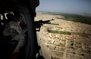 An US soldier mans his machine gun from a helicopter over Kandahar, Afghanistan.