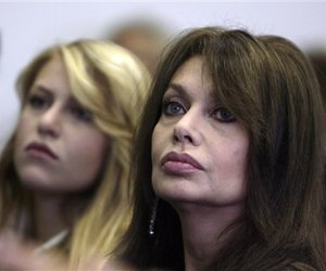 In this 2008 photo, Silvio Berlusconi's soon-to-be-ex-wife Veronica Lario, right, and her daughter Barbara are seen at a meeting in Milan, Italy.