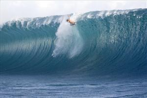 In this image released by the Association of Surfing Professionals (ASP), surfer Bruce Irons, of Hawaii, wipes out on a huge wave, Sunday, April 29, 2007 in Teahupoo, Tahiti.