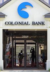 Employees lock the doors to a branch of the Colonial Bank in Montgomery, Alabama yesterday.