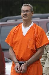 Billionaire R. Allen Stanford is escorted into the federal courthouse in Houston this June.