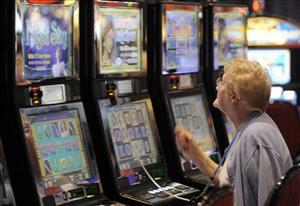 A woman plays the slot machines at the grand opening of the Sands Casino Resort Bethlehem in Bethlehem, Pa.