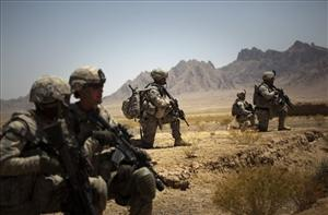 Soldiers from the 5th Stryker Brigade take position next to Sari Ghundi village in Afghanistan, near the Pakistani border, Monday, Aug. 10, 2009.