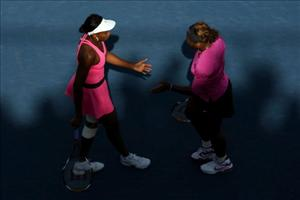 Venus and Serena Williams during their match against Julia Goerges of Germany and Arantxa Parra Santonja of Spain during day four of the 2009 US Open. The Williams sisters won 6-2, 6-2.