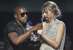 Singer Kanye Westgrabs the microphone from Taylor Swift as she accepts the Best Female Video award during the MTV Video Music Awards in New York last night.