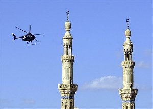 A private security helicopter flies over Ibn Taimiyah Mosque in Baghdad Wednesday Nov. 24 2004, after a car bomb exploded nearby. A top aide to Prime Minister Nouri al-Maliki conceded it may prove difficult for the Iraqi government to expel Western security contractors despite outrage that followed the killings of...