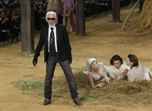 German fashion designer Karl Lagerfeld reacts after the presentation of Chanel's spring summer 2010 ready-to-wear fashion collection presented in the Grand Palais museum in Paris, Oct. 6, 2009.