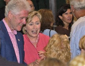 Former President Bill Clinton and his wife Sen. Hillary Clinton, democratic presidential hopeful greet a crowd during a fundraiser, Saturday, Aug. 25, 2007 at the Tabernacle at Oak Bluffs, a town on the island of Martha's Vineyard, Mass. (AP Photo/Lisa Poole)