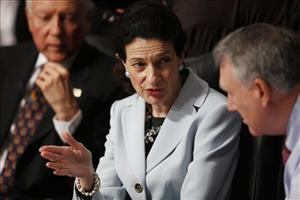 Sen. Olympia Snowe confers with fellow Republican Senate Finance Committee members Jon Kyl and Orrin Hatch, left, today.