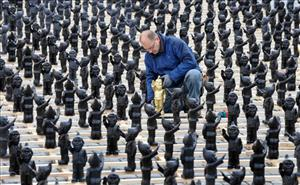 German artist Ottmar Hoerl's assistant positions  saluting Nazi gnomes.