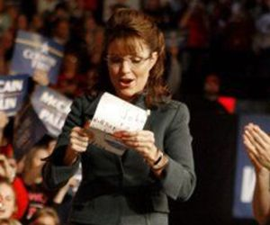 Republican vice presidential candidate Sarah Palin reads a letter handed to her Sunday, Nov. 2, 2008 during a rally in Ohio at the Canton Memorial Field House.