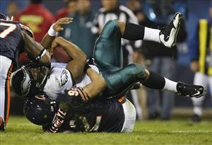 Eagles quarterback Donovan McNabb (5) is tackled in the second quarter of yesterday's game in Chicago, a 24-20 upset by Philadelphia.
