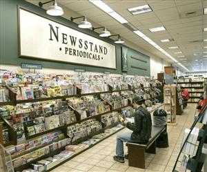 In this May 18, 2009 file photo, a customer reads magazines inside the Barnes and Noble store in Tallahassee, Fla.