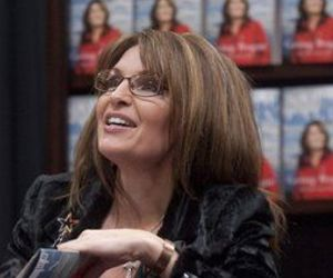 Former Alaska Gov. Sarah Palin signs a copy of Going Rogue Dec. 3, 2009, in Fayetteville, Ark.