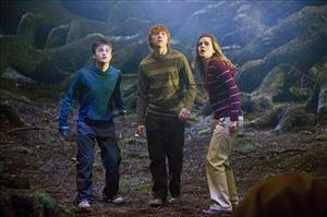 This undated photo supplied by Warner Bros. shows Daniel Radcliffe, left, Rupert Grint, center, and Emma Watson in a scene from   Harry Potter and the Order of the Phoenix.