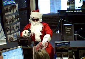 This image made from video released by the Metropolitan Nashville Police Department shows a man dressed as Santa robbing the Sun Trust Bank in Nashville, Tenn.