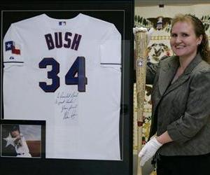Dr. Jennifer M. Schulle is shown with a sampling of gifts to former President George W. Bush, Tuesday, July 7, 2009 in Lewisville, Texas.