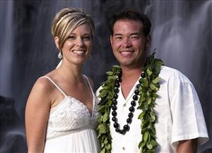 This image released by TLC, shows Jon Gosselin, right, and his wife Kate Gosselin, from the TLC series Jon and Kate Plus 8 in Hawaii.