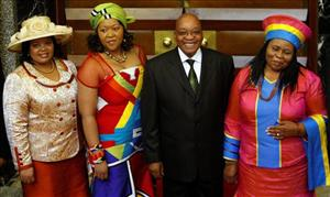 South African president Jacob Zuma poses with wives Sizakele Khumalo, right, Nompumelo Ntuli, left, and bride-to-be Thobeka Mabhija, second left.