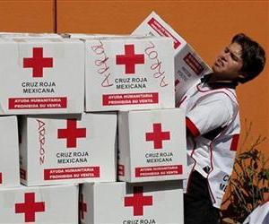 A Mexican Red Cross worker loads humanitarian aid leaving for Haiti at the Mexican Red Cross building in Mexico City, Thursday, Jan. 14, 2010.