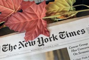 In this photo made Wednesday, Oct. 21, 2009, the New York Times appears for sale on a newspaper rack inside a coffee shop in Chagrin Falls, Ohio.
