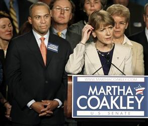 In this Jan. 19, 2010 file photo, Massachusetts Gov. Deval Patrick, left, listens to Massachusetts Attorney General Martha Coakley concede after losing a special election in Boston, Jan. 19, 2010.