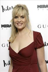 Actress Emmanuelle Seigner, arrives to the New York premiere of her film 'The Diving Bell and the Butterfly.'