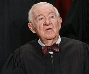 Associate Justice John Paul Stevens sits for a new group photograph, Tuesday, Sept. 29, 2009, at the Supreme Court in Washington.