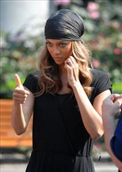 TV personality Tyra Banks tapes a dance mob segment for The Tyra Banks Show and also traded in her weave and revealed her natural hair for her 5th season celebration, in New York, on August 17, 2009.