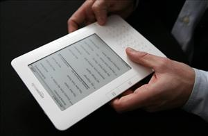 In this Feb. 9, 2009 file photo, the Kindle 2 electronic reader is shown at an Amazon.com news conference in New York.