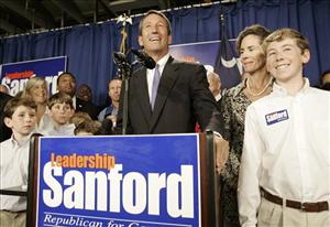 A Tuesday, Nov. 7, 2006, file photo shows South Carolina Gov. Mark Sanford, joined by wife Jenny and sons, after winning his second term by defeating Democrat Tommy Moore, in Columbia, SC.