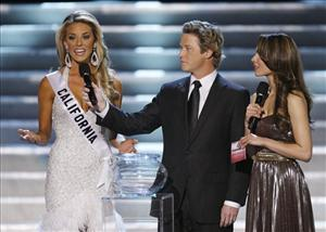 Miss California Carrie Prejean answers judge Perez Hilton's question about same-sex marriage during the Miss USA Pageant in Las Vegas, April 19, 2009. Hosts Billy Bush and Nadine Velazquez listen.