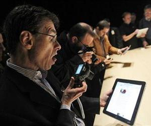 In this Jan. 27, 2010 file photo, the Apple iPad is examined after its unveiling at the Moscone Center in San Francisco.