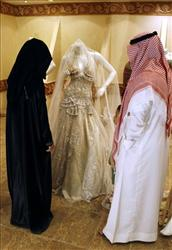A Saudi couple buy a wedding dress at a shop in Riyadh, Saudi Arabia.