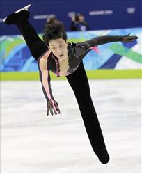 Johnny Weir (US) could be called Lady Gaga on ice, because he never fails to bring out the crazy, including this black number with pink trim, ruffles, sequins, and what appears to be pleather.