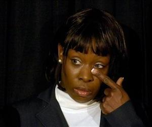 Crystal Mangum, the alleged victim in the Duke lacrosse rape case, wipes away a tear during a press conference on the release of her book, Oct. 23, 2008.