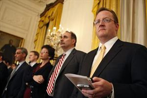 Robert Gibbs, right, listens with David Axelrod and Valerie Jarrett, and Rahm Emanuel, as President Barack Obama speaks during a news conference, March 24, 2009.