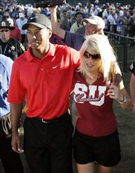 In a file photo Tiger Woods celebrates with wife Elin Nordegren after winning the 88th PGA Championship golf tournament at Medinah Country Club Sunday, Aug. 20, 2006, in Medinah, Ill.